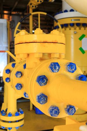 water flow: Check valve in a production facility to control flow direction Stock Photo
