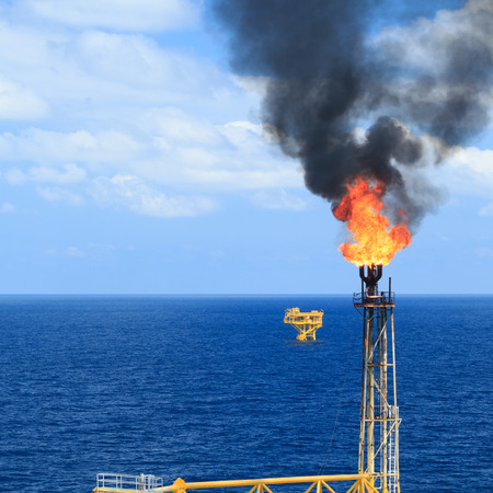 oil and gas: Hot flare boom and fire on offshore production platform Stock Photo