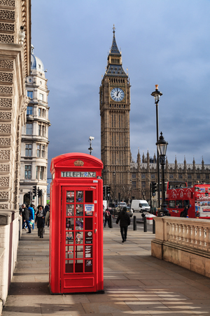 red telephone: LONDON, UNITED KINGDOM – 25 JANUARY 2016: Traditional Red Telephone Box and Big Ben in London, UK