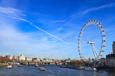 london eye: LONDON, UNITED KINGDOM – 25 JANUARY 2016: London Eye is the tallest Ferris wheel in Europe and Country Hall in London, United Kingdom Editorial