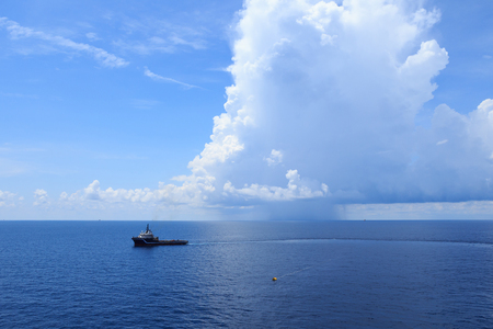 offshore jack up rig: Offshore Supply Vessel For Oil Drilling Rig in The Middle Of Ocean Stock Photo