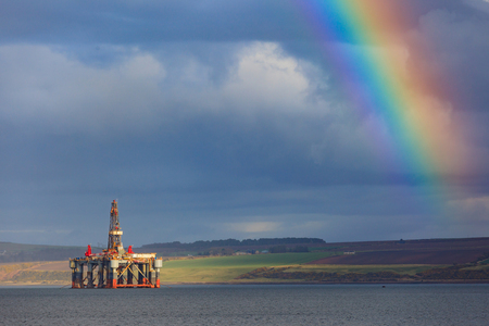buoyancy: Semi Submersible Oil Rigs and Rainbow at Cromarty Firth in Invergordon, Scotland