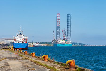 offshore jack up rig: Jack up oil drilling rig in the shipyard for maintenance in Dundee, Scotland, UK