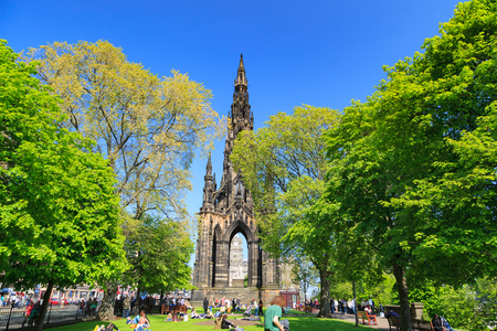 scott monument: EDINBURGH - MAY 29, 2016: Princes Street garden with Scott Monument full of people in a sunny summer day, on 29th May 2016