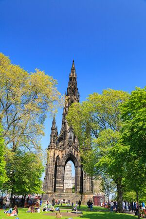 walter scott: EDINBURGH - MAY 29, 2016: Princes Street garden with Scott Monument full of people in a sunny summer day, on 29th May 2016