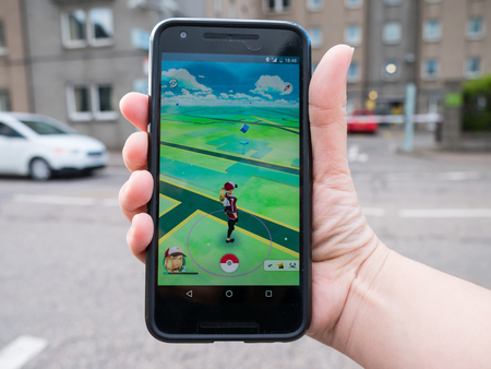 ABERDEEN, UNITED KINGDOM - JULY 15, 2016: People playing Pokemon GO the hit augmented reality smart phone app while trying to find Pokemon on July 15, 2016 in Aberdeen, United Kingdom.
