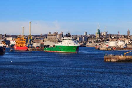docked: ABERDEEN SCOTLAND - 30 January 2016: Big supply boats in Abeerden harbor on 30 January 2016. Aberdeen port is one of the busiest ports in UK. Editorial