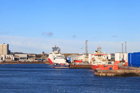 moorings: ABERDEEN SCOTLAND - 30 January 2016: Big supply boats in Abeerden harbor on 30 January 2016. Aberdeen port is one of the busiest ports in UK. Editorial