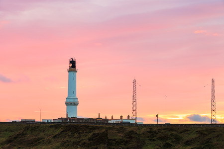 girdle: Girdle Ness lighthouse During Sunrise in Aberdeen, Scotland UK Stock Photo