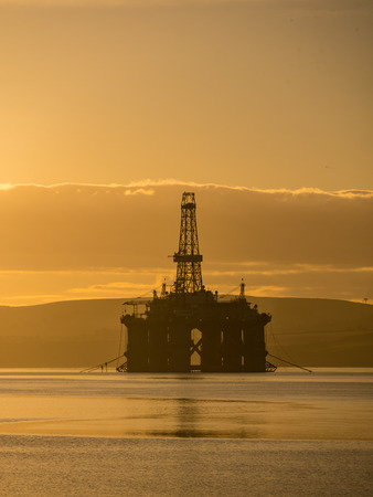 Stacked Semi Submersible Oil Rig at Cromarty Firth in Invergordon, Scotland, UK? Many offshore drilling rig parked and waiting for drilling work offshore North Sea Stock Photo