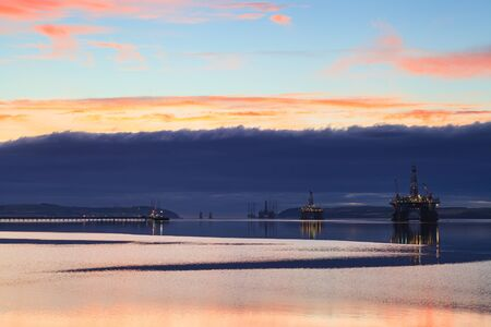 oil and gas: Semi Submersible Oil Rig during Sunrise at Cromarty Firth in Invergordon, Scotland