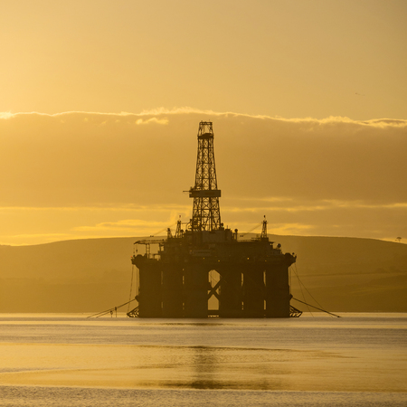 Stacked Semi Submersible Oil Rig at Cromarty Firth in Invergordon, Scotland, UK Stock Photo