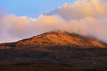 highlands region: Beautiful mountain peak during sunset with dramatic cloud, Isle of Skye, Hightland, Scotland Stock Photo