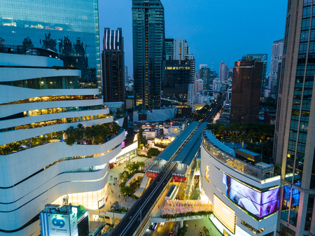Bangkok, Thailand - May 1, 2017: Aerial shot of The Emporium and Emquartier Department Store in Bangkok, Thailand at night time. The place is called The EM District in Bangkok with the Emporium, and the EmSphere.