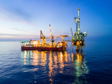 Aerial View of Tender Drilling Oil Rig (Barge Oil Rig) in The Middle of The Ocean at Night