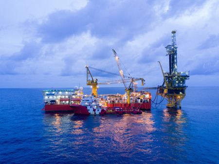 Aerial View of Tender Drilling Oil Rig (Barge Oil Rig) in The Middle of The Ocean at Sunrise Time Stock Photo