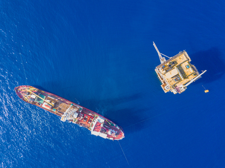Soil Boring Boat (a geotechnical drilling  analogue survey vessel) close to a oil platform Stock Photo