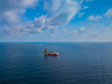 Aerial View of Tender Drilling Oil Rig (Barge Oil Rig) in The Middle of The Ocean