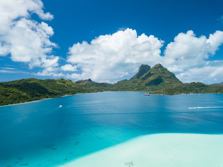 Aerial image from a drone of blue lagoon and Otemanu mountain at Bora Bora island, Tahiti, French Polynesia, South Pacific Ocean (Bora Bora Aerial)