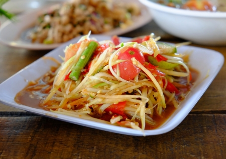 Thai papaya salad or Som Tum  traditional thai food  photo
