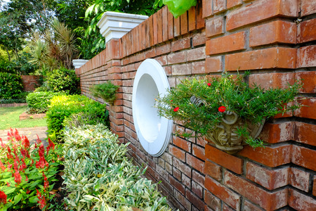 Garden and brick wall background photo