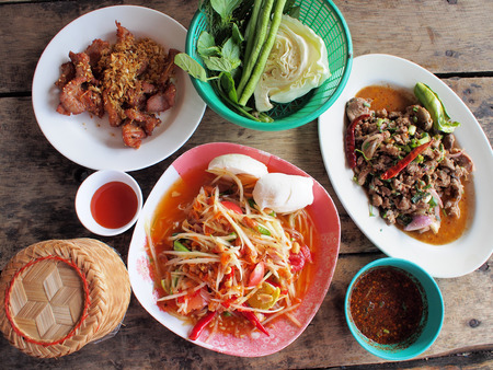 Spicy green papaya salad, spicy duck salad, fried pork  traditional thai food  photo