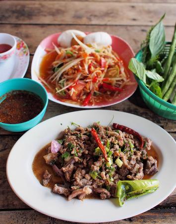 Spicy green papaya salad, spicy duck salad  traditional thai food  photo