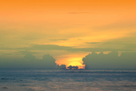 The sun began to rise from the sea in the morning. Stock Photo