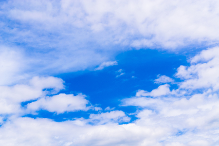 clear blue sky with plain white cloud with space for text. Standard-Bild
