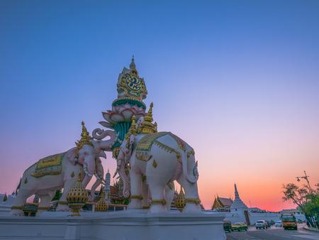 adulyadej: Bangkok, Thailand - January 22, 2016. Tourist came to Wat Phra Kaew will see White elephant statue built to celebrate King Bhumibol Adulyadej Rama 9 84th birthday on December 5, 2011