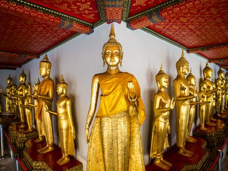 transcendental: Bangkok, Thailand - January 22, 2016. Buddha at Wat Pho long corridor. Many tourist coming to visit the beautifuly temple in Bangkok.