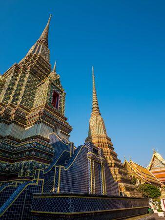 transcendental: Bangkok, Thailand - January 22, 2016. Pagoda at Wat Pho. Many tourist coming to visit the beautifuly temple in Bangkok.