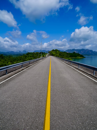 Road on Ratchaprapha Dam or Khao Sok Dam is in Surat Thani Province, Thailand Stock Photo
