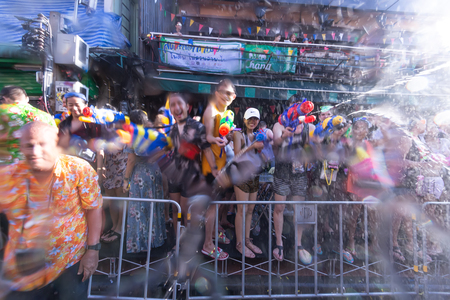 Bangkok, Thailand - April 13, 2018 : Famous Songkran Festival at Khao San Road, Bangkok, Thailand on April 13, 2018 Foreigner and Thai people celebrate Songkran on Khao San Road, Bangkok