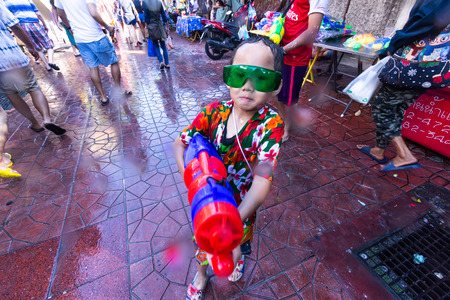 Bangkok, Thailand - April 13, 2018 : Famous Songkran Festival at Khao San Road, Bangkok, Thailand on April 13, 2018 Thai kids celebrate Songkran on Khao San Road, Bangkok