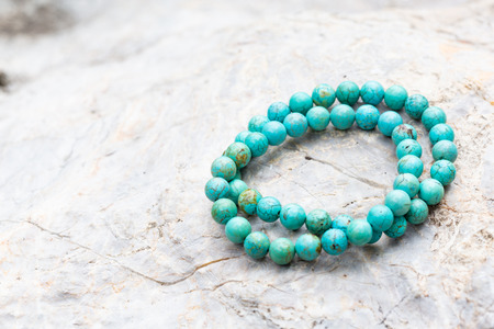 The Turquoise stone bracelet on the rock