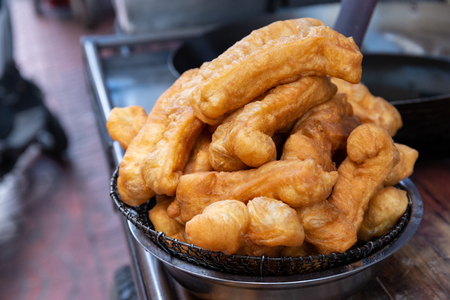 Youtiao or Chinese breadstrick also known as Chinese fried dough or Chinese crullers