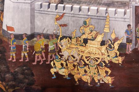 Traditional Thai painting (Art wall) of Ramayana story in the grand palace of Bangkok Thailand