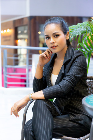 Asian Beautiful business woman sit on the chair