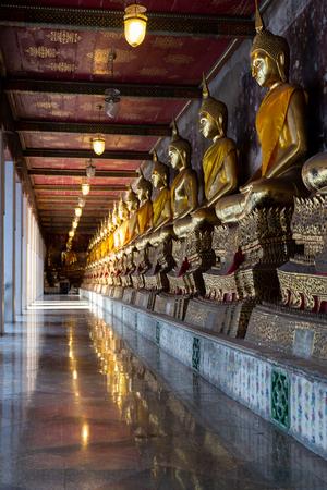 The Budha Corridor at Wat Suthat Thepwararam, Bangkok, Thailand