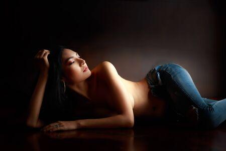 Female Topless model wearing jeans