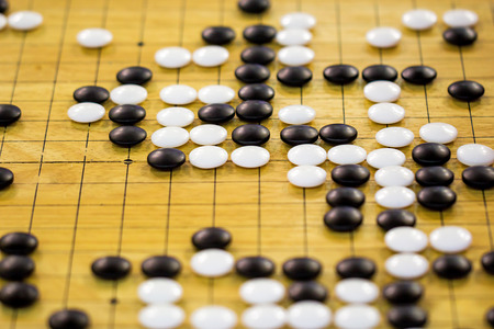 strategical: closeup of stones on a Go board