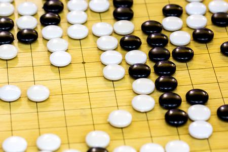 closeup of stones on a Go board