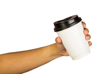 hand of woman holding a cup of coffee, isolated on white background Standard-Bild