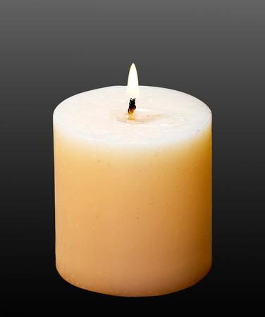 Candle on black background