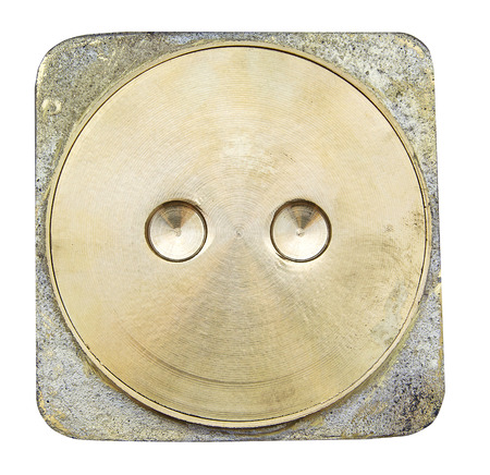 empty the bowel: Brass toilet lid on white background