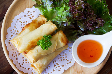 thai culture: fried spring rolls on wooden table Stock Photo