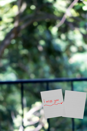 i miss you: I miss you word sticky note on window mirror