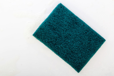 scouring: scrubber pad with sponge and bubble of washing liquid