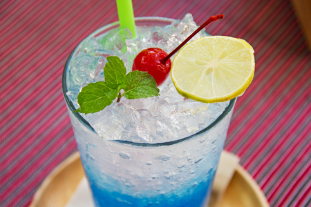 blue hawaiian drink: blue hawaiian soda with peppermint and lemon on top Stock Photo